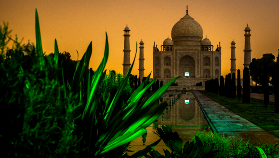 Taj_Mahal_in_Midnight_with_City_Lights_illuminating_the_background.jpg